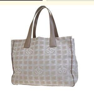Chanel monogram canvas traveler bag